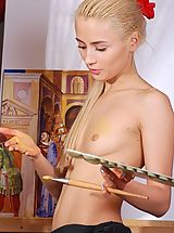 Naked skinny blonde girl painting herself