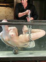 Hot sexy girl is tied, gagged, suspended while suffering through water tortures.