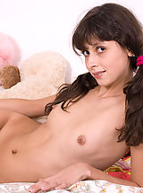 Irresistibly beautiful teen girl gets rid of her clothes just to let you see her spots.