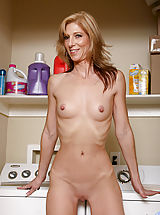 Small.Tits Pics: Attractive mature cougar shows off her elongated nipples in the laundry room