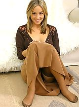 Small Breasts, Melanie in a revealing brown top and long brown dress.