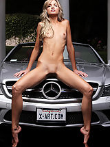 Skinny blond Francesca strips out of her tiny silver bikini and straddles a sleek silver sports car...